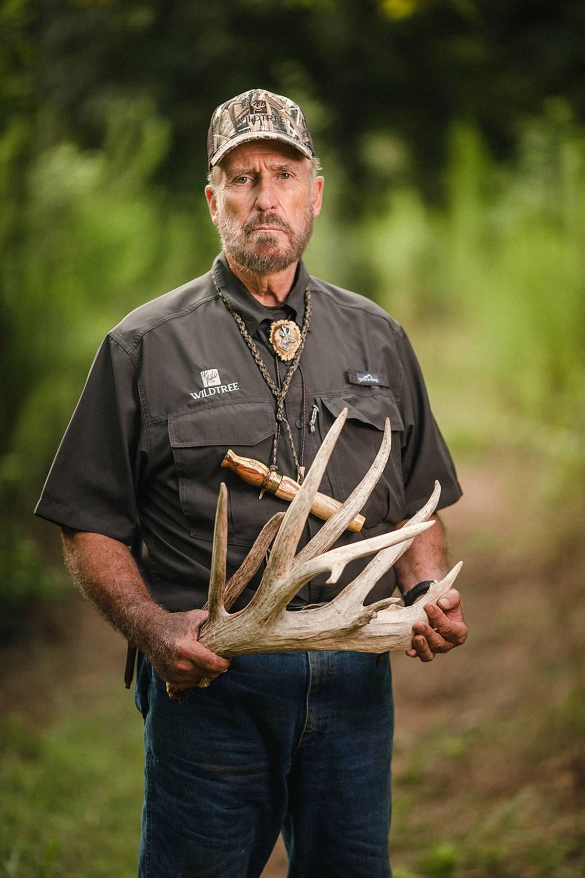 Dr. Deer holding an antler